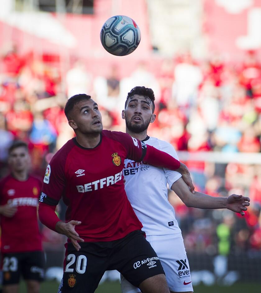 Real Mallorca defender Aleksandar Sedlar, left,  vies with Sevilla forward Munir El Haddadi during a match Dec. 21.