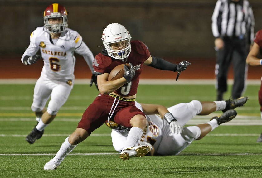 Ocean View running back Anthony Ramirez runs to the outside for a big gain against Estancia on March 12.