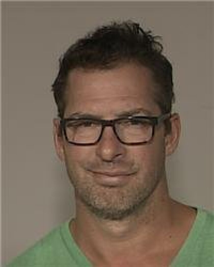 In this Aug. 20, 2015, booking photo made available by the Anoka County Sheriff's office, Minnesota Wild NHL assistant coach Darryl Sydor is shown. Sydor has been charged with drunken driving after being arrested while taking his 12-year-old son to a hockey game. He has been an assistant coach for the past four seasons and also played 18 seasons in the NHL. (AP Photo/Anoka County Sheriff)