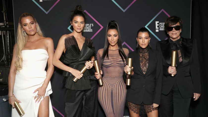 Reality stars Khloe Kardashian, left, Kendall Jenner, Kim Kardashian West, Kourtney Kardashian and their mother, Kris Jenner.