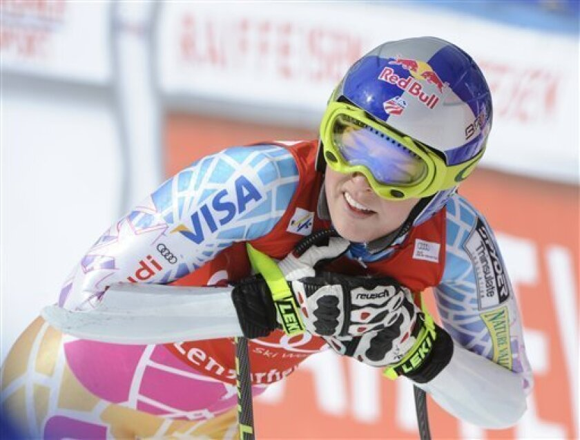 Lindsey Vonn, of the United States, reacts at finish line after clocking the seventh fastest time during a training session for the alpine ski, World Cup women's downhill final, in Lenzerheide, Switzerland , Tuesday, March 15, 2011. (AP Photo/Giovanni Auletta)