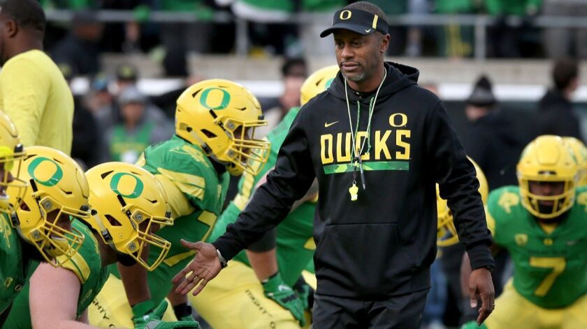 Former Oregon head coach Willie Taggart, center, greets players during warmups before a game against Arizona on Nov. 18.