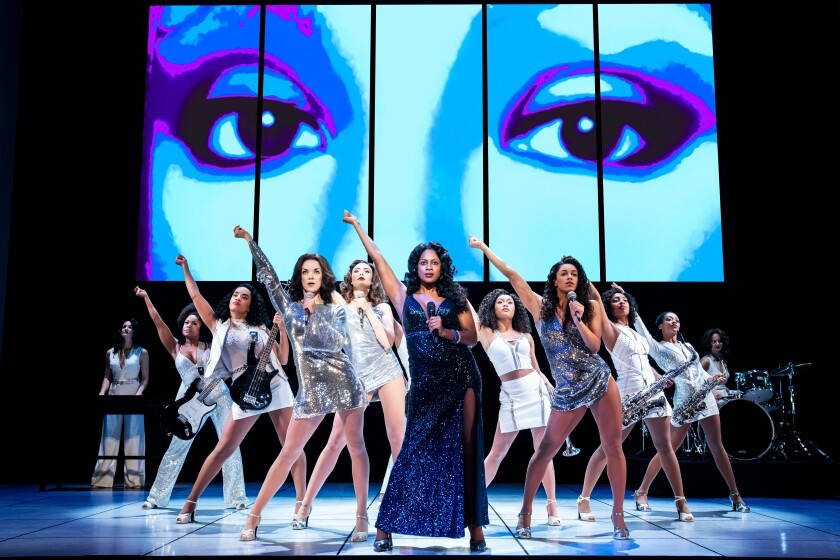 "Dan'yelle Williamson as Diva Donna with the company of ""Summer: The Donna Summer Musical."""