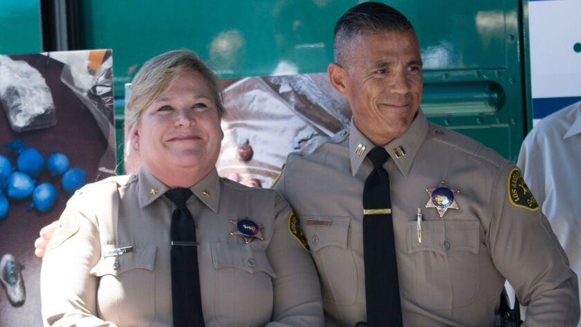 SANTA CLARITA, CA - JUNE 28, 2017: L.A. Sheriff's Commander Judy Gerhardt, left, standing with Santa