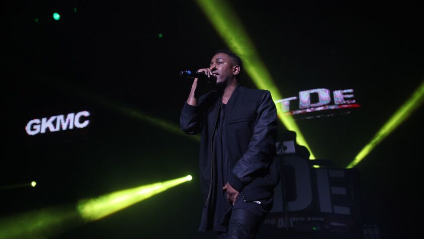 Artist Kendrick Lamar performs at a 2012 Cali Christmas concert in Los Angeles sponsored by hip-hop radio station Power 106.