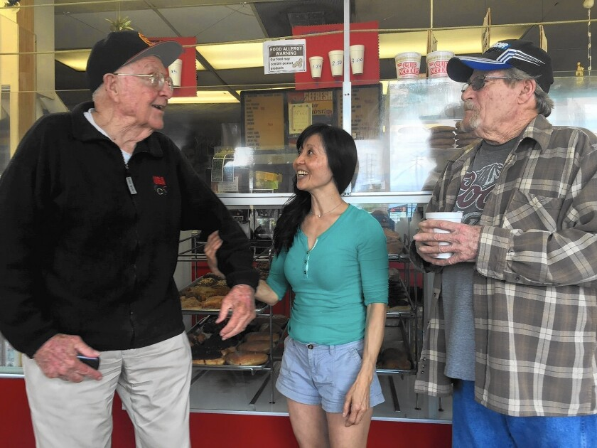 Tom House, left, Sing Yam and Harry Jarvis at Rainbow Donuts in West Covina. The shop's regulars are unhappy about plans to build a Dunkin' Donuts nearby.