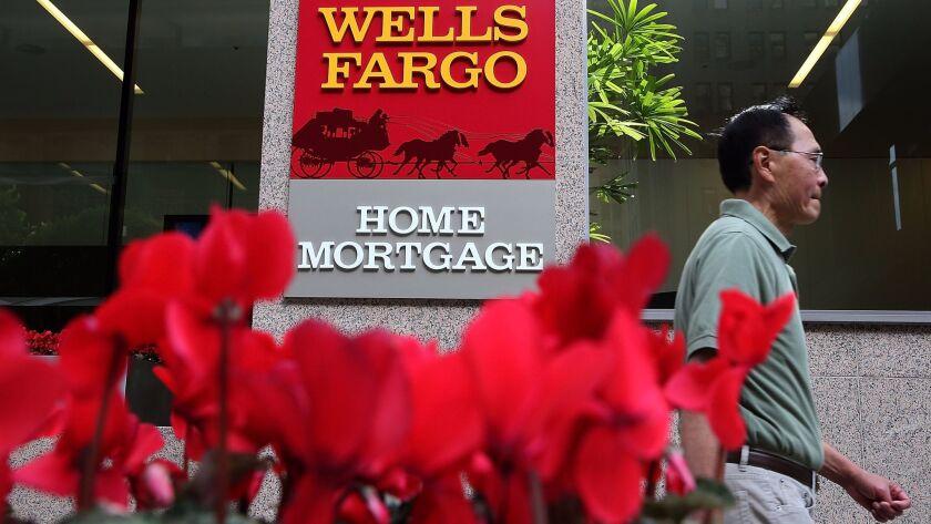 A man walks by a Wells Fargo office in San Francisco in 2013.