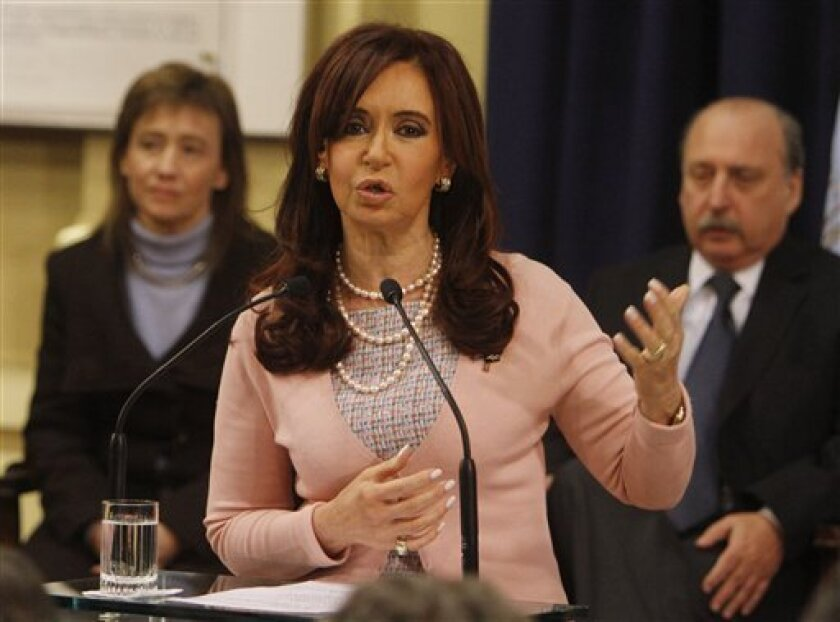 Argentina's President Cristina Fernandez speaks after signing the same sex marriage bill at the Latin America Patriots room of the government house in Buenos Aires, Wednesday, July 21, 2010. Argentina became the first nation in Latin America to grant same-sex marriages all the rights of heterosexual unions. (AP Photo/ Eduardo Di Baia)