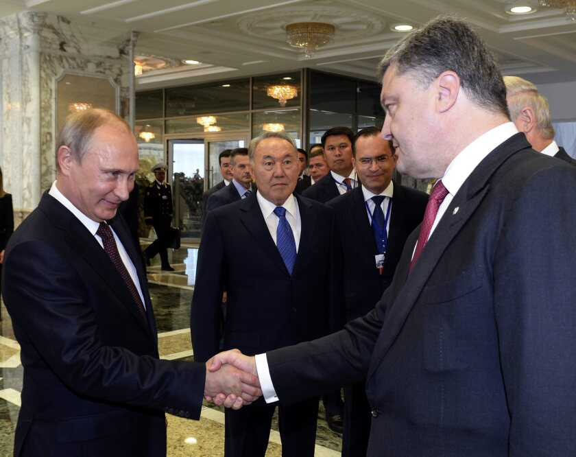 Russian President Vladimir Putin shakes hands with Ukrainian President Petro Poroshenko in Minsk, Belarus, on Aug. 26.