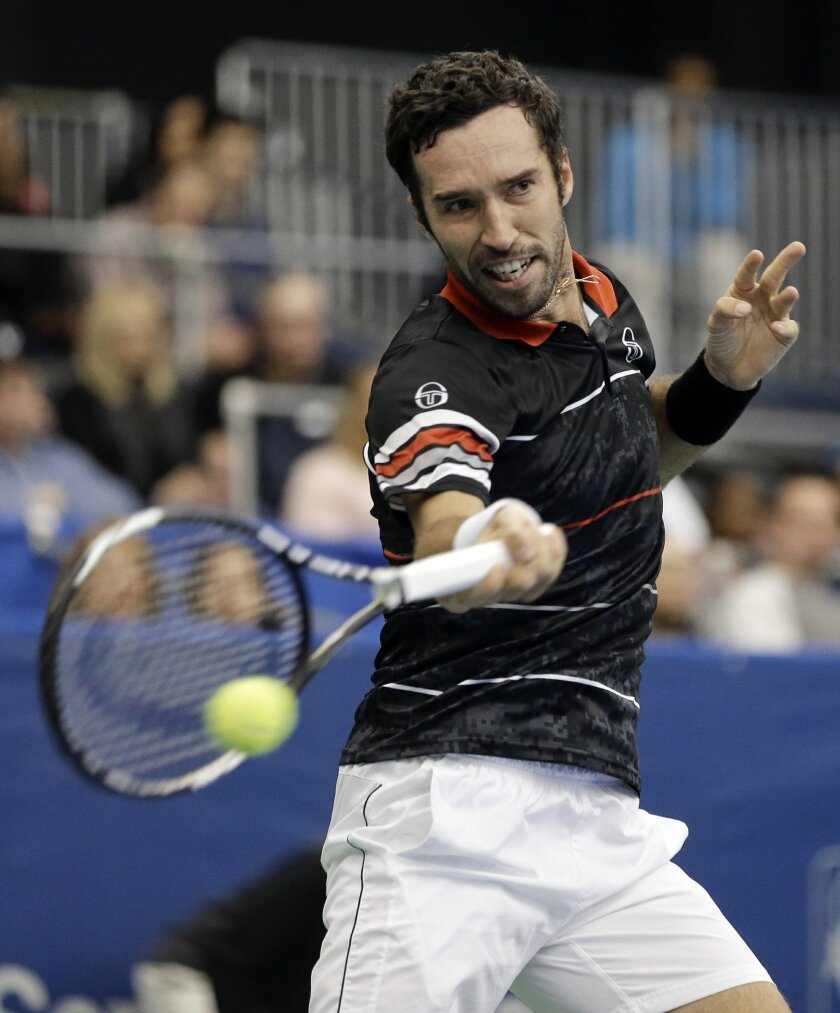 Mikhail Kukushkin, of Kazakhstan, returns a shot to Kei Nishikori, of Japan, in a quarterfinal at the Memphis Open tennis tournament Friday, Feb. 12, 2016, in Memphis, Tenn. (AP Photo/Mark Humphrey)