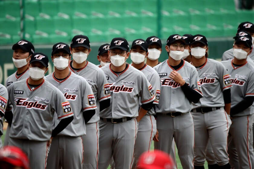 South Korean's Hanwha Eagles players wear masks pre-game.