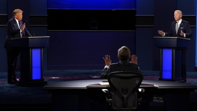 Moderator Chris Wallace speaks as President Trump and  Joe Biden speak during the first presidential debate