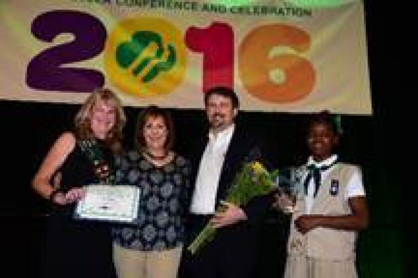 Sue Major (left) accepts the Courage, Confidence and Character Award from Girl Scouts San Diego Board Chair Rick Brooks, Interim Fund Development Director Merle Brodie and Cadette Shalene Bryant.