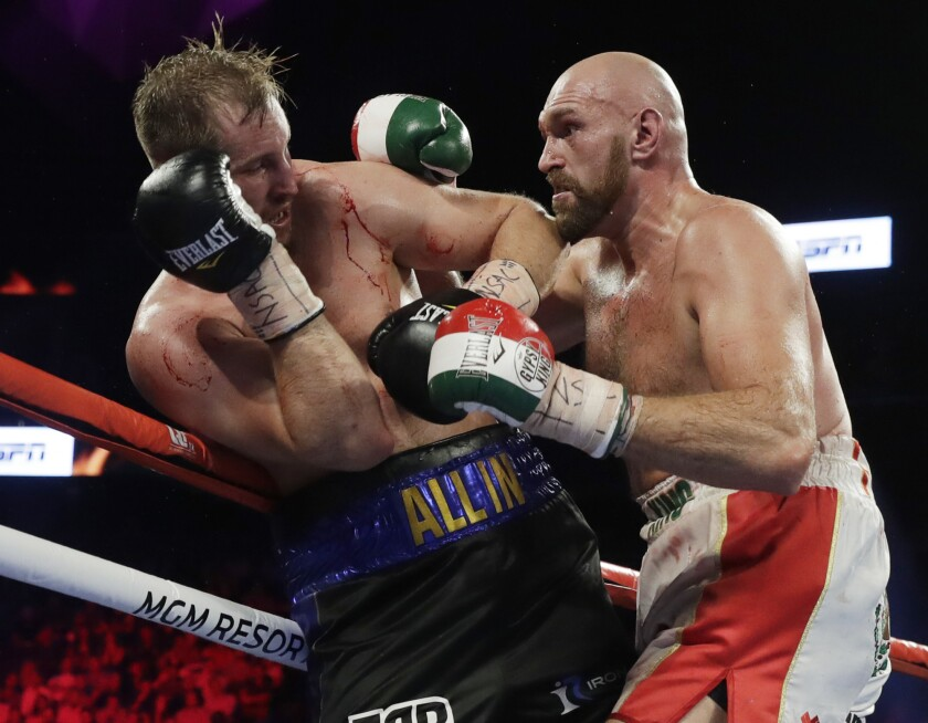 Tyson Fury, right, punches Otto Wallin during their heavyweight boxing match Saturday.
