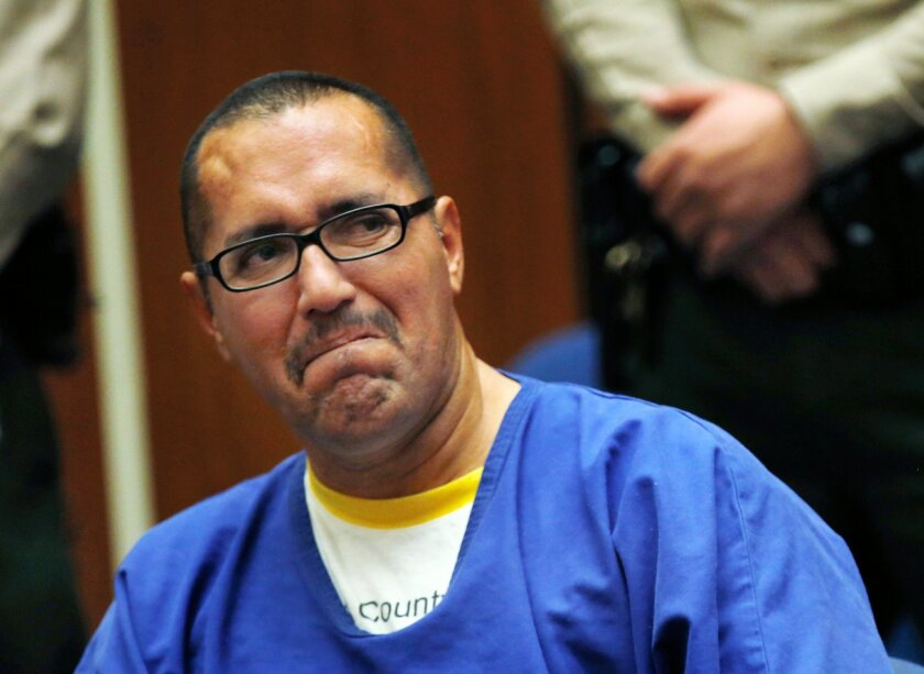 Luis Vargas, who has been in prison for 16 years, reacts in court as he is exonerated Monday, Nov. 23, 2015, in Los Angeles. A judge exonerated Vargas, convicted of three rapes, after DNA evidence linked the crimes to a serial rapist wanted for assaults dating back two decades. (Francine Orr/Los An