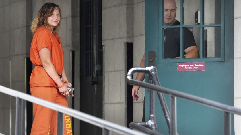 Reality Winner arrives at a courthouse in Augusta, Ga. on Aug. 23, after she pleaded guilty in June to copying a classified U.S. report and mailing it to an unidentified news organization.
