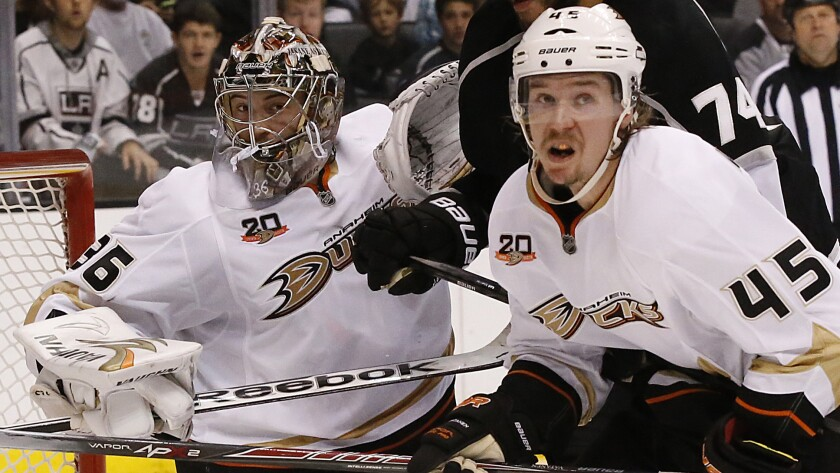 Ducks goalie John Gibson and defenseman Sami Vatanen keep their eyes on the puck during the team's win over the Kings in Game 4 of the Western Conference semifinals Saturday. Gibson will be back in the crease for Game 5.