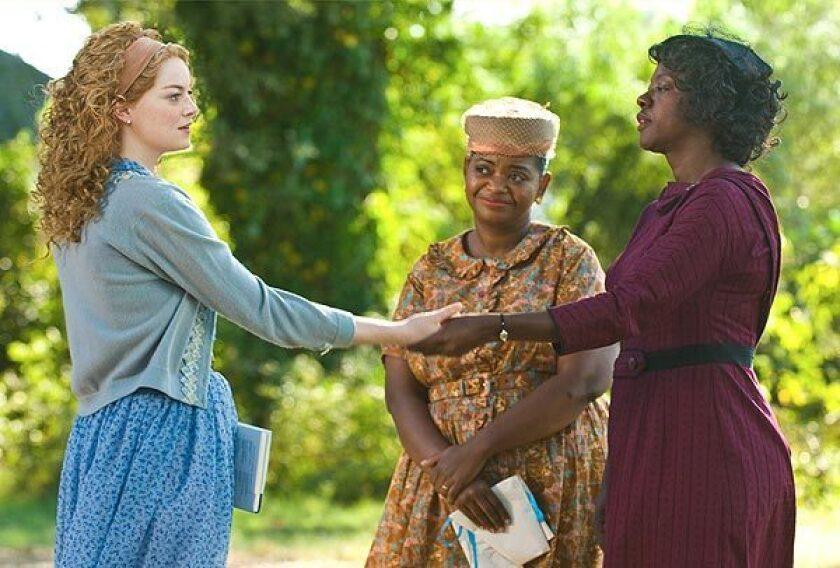 "Emma Stone, left, Octavia Spencer and Viola Davis in ""The Help"" (2011)."