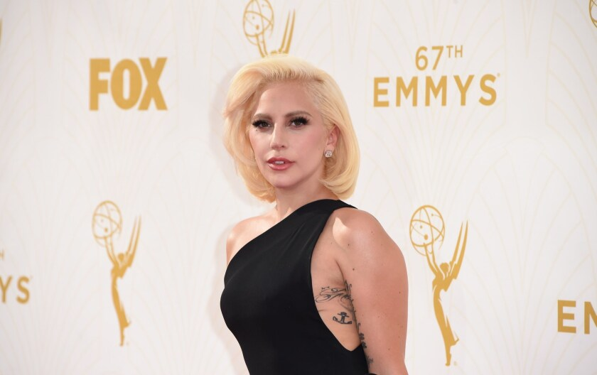 Lady Gaga channels understated glamour on the red carpet at the Emmy Awards.
