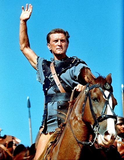 """Kirk Douglas not only starred in """"Spartacus,"""" he produced it, and as producer he secretly hired the blacklisted Dalton Trumbo to write the screenplay."""