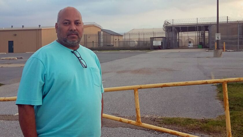 John Chavez, a former security guard at the Willacy County Correctional Center in Raymondville, Texas, stands outside the closed facility.