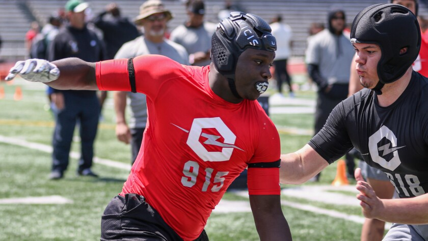Orange Vista defensive end Dion Wilson Jr. tries to get around the edge against USC offensive lineman commit Caadyn Stephen at the Opening Oakland Regional on May 11.