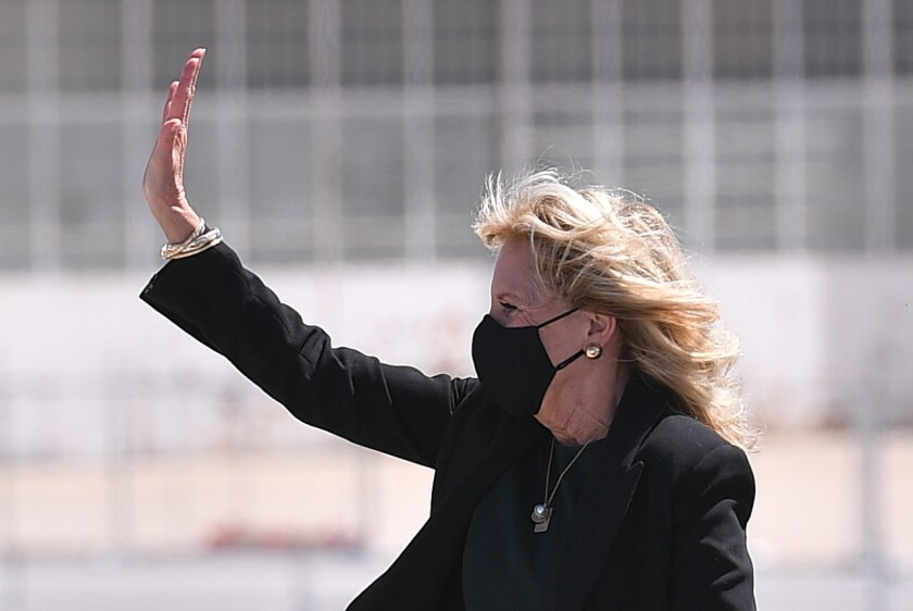 First lady Jill Biden boards a plane before departing from Meadows Field Airport in Bakersfield, Calif., Thursday, April 1, 2021. (Mandel Ngan/Pool via AP)