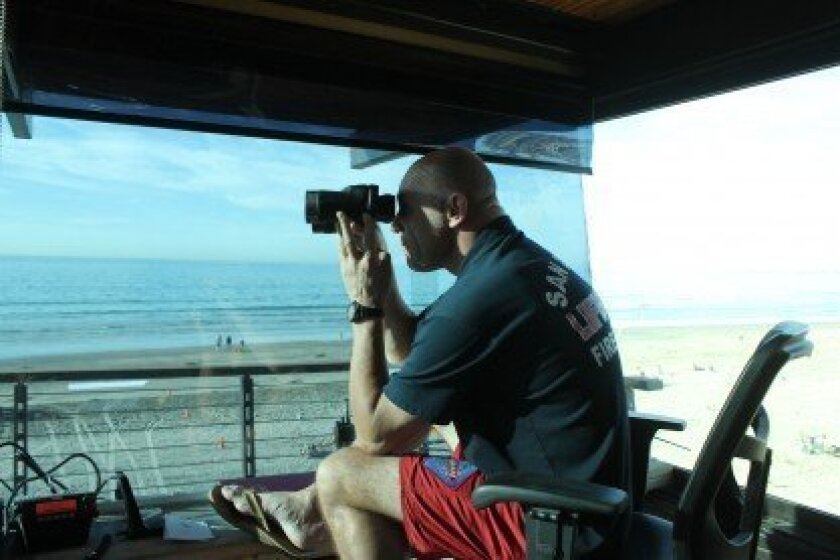 While lifeguard such as John Kerr (pictured) scan La Jolla Shores beach, their vision is partially obscured.  Pat Sherman