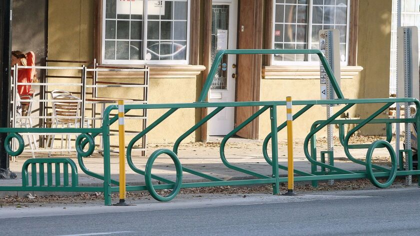 A bike corral shaped like a car in front of Tony's Darts Away. The Burbank City Council decided to continue with its bike corral pilot program.