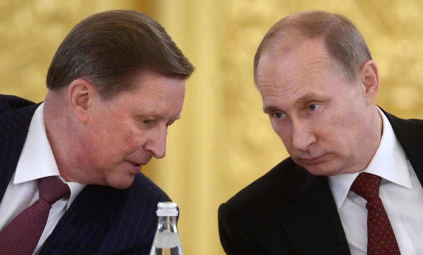 In this 2014 file photo, Russian President Vladimir Putin, right, listens to his chief of staff Sergei Ivanov during a meeting in the Kremlin in Moscow.