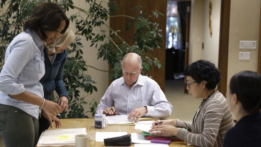California Gov. Jerry Brown prepares to sign one of hundreds of bills he has left to take action on in his Capitol office in Sacramento on Oct. 9 of last year.