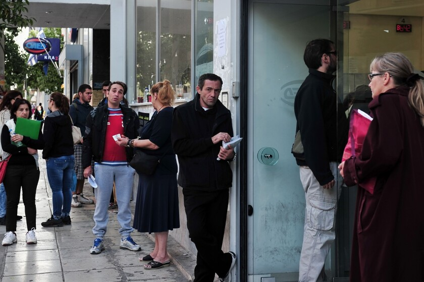 Job seekers line up outside an employment office in Athens. Global unemployment climbed to 202 million in 2013 as countries fail to keep pace with growth in the labor force, the International Labour Organization said.