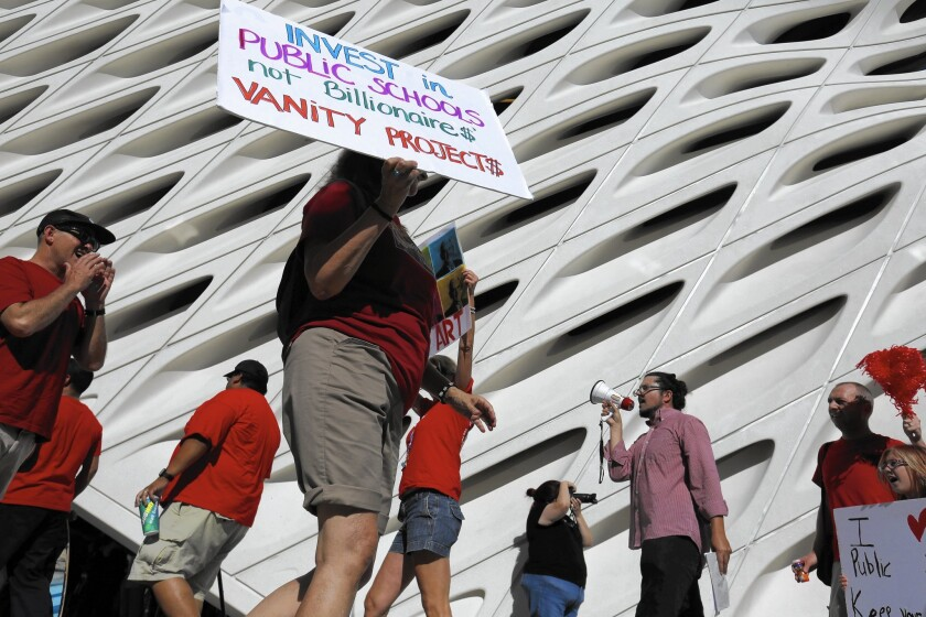 Members of the United Teachers Los Angeles union protest last month on the opening day of the Broad, a new L.A. art museum. The Eli and Edythe Broad Foundation is spearheading a $490-million plan to open 260 new charter schools in L.A. in eight years.