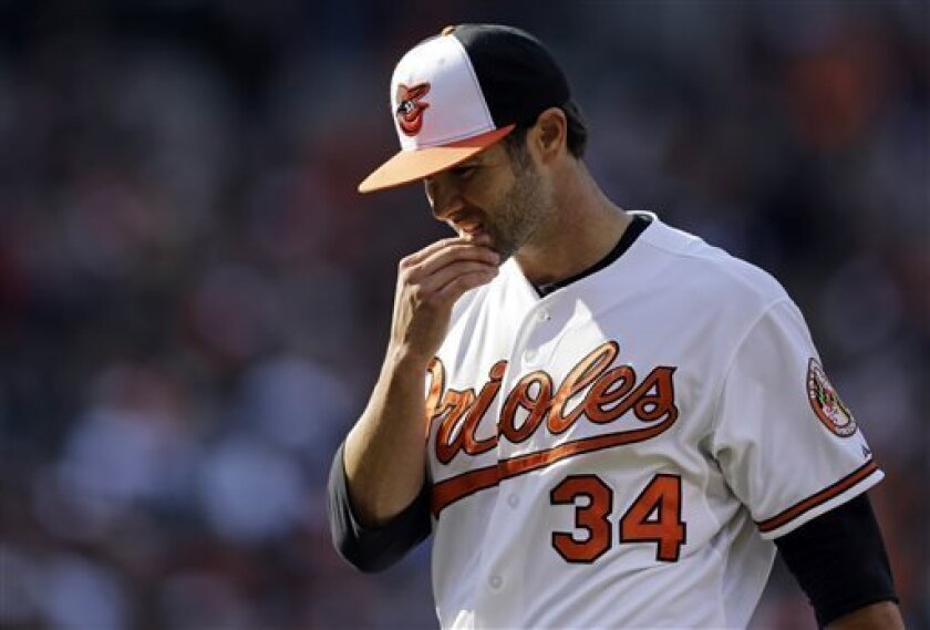Baltimore Orioles starting pitcher Jake Arrieta walks off the field after the top of the fourth inning of their home-opener baseball game against the Minnesota Twins on Friday, April 5, 2013, in Baltimore. (AP Photo/Patrick Semansky)