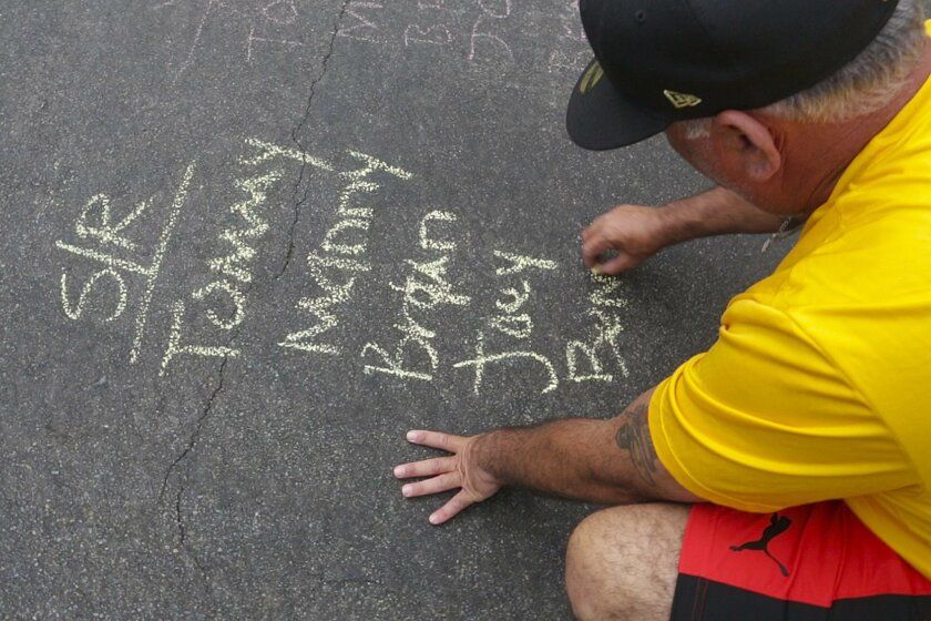 SAN DIEGO, CALIFORNIA, USA - SEPTEMBER 4, 2016: Street Rookies team member Steven Ayala chalks out the batting order for Sunday's game at the Labor Day Stickball Tournament played in Little Italy of San Diego. Mandatory Credit: PHOTO BY NELVIN C. CEPEDA, SAN DIEGO UNION-TRIBUNE