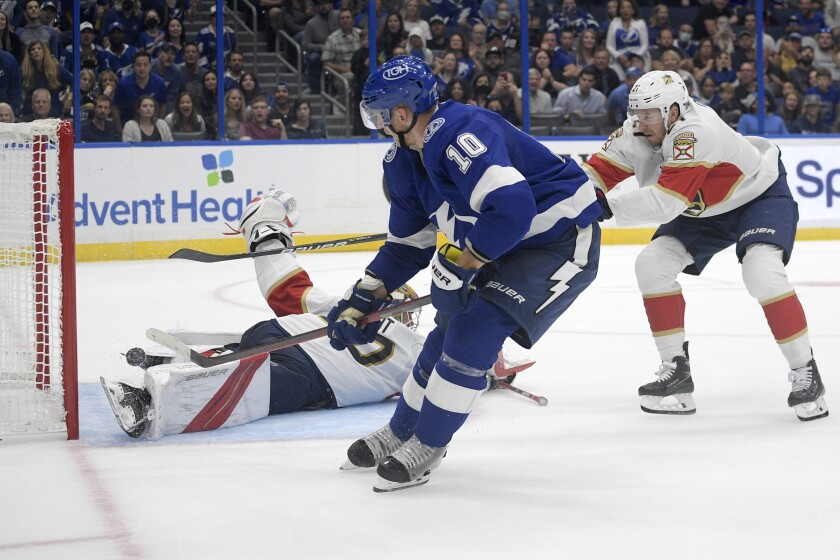 Tampa Bay Lightning right wing Corey Perry (10) scores past Florida Panthers goaltender Spencer Knight and center Zac Dalpe, right, during the second period of a preseason NHL hockey game Thursday, Oct. 7, 2021, in Tampa, Fla. (AP Photo/Phelan M. Ebenhack)