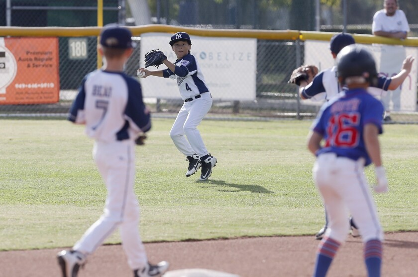 Seaview Little League No. 2 team's Dylan Morales (4) looks to turn two after making the catch in out