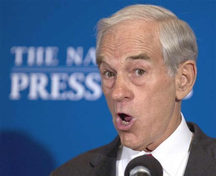 Republican presidential candidate, Rep. Ron Paul, R-Texas, speaks at the National Press Club in Washington, Wednesday, Oct. 5, 2011. (AP Photo/Carolyn Kaster)