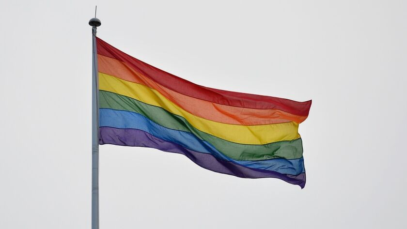 A gay pride flag flies over Whitehall in central London on March 28, 2014.