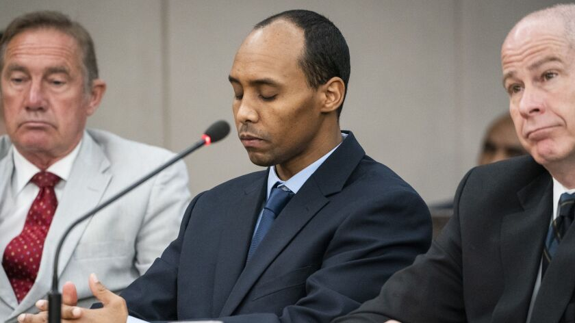 Mohamed Noor, center, listens to victim impact statements during his sentencing hearing June 7 in Hennepin County District Court in Minneapolis.