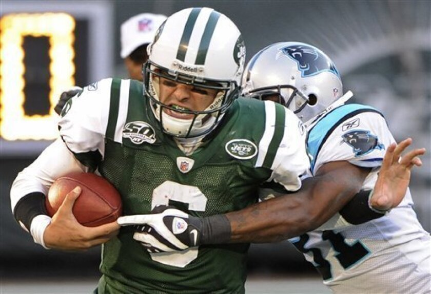 New York Jets quarterback Mark Sanchez (6) is tackled by Carolina Panthers cornerback Richard Marshall (31) in the third quarter during an NFL football game Sunday, Nov. 29, 2009, in East Rutherford, N.J. (AP Photo/Bill Kostroun)