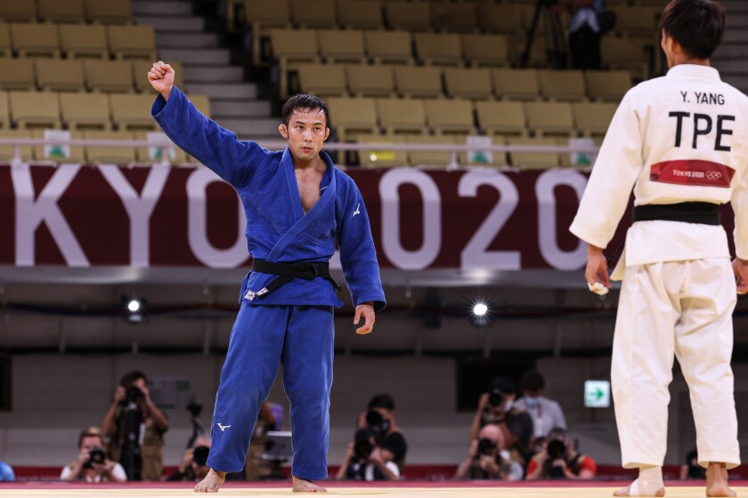 Naohisa Takato of Japan celebrates after winning judo gold
