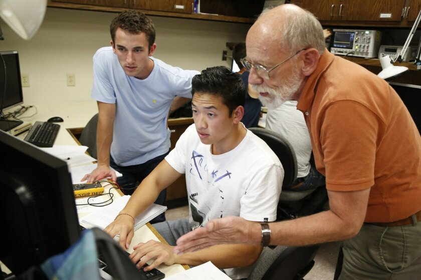 Professor Tom Schubert goes over lab work with Carson Drake, 21, and Nathan Udomsri, 20 at one of University of San Diego's Electronics Laboratories. Darlene Shiley is donating $20 million to the University of San Diego to turn its department of engineering into a School of Engineering.