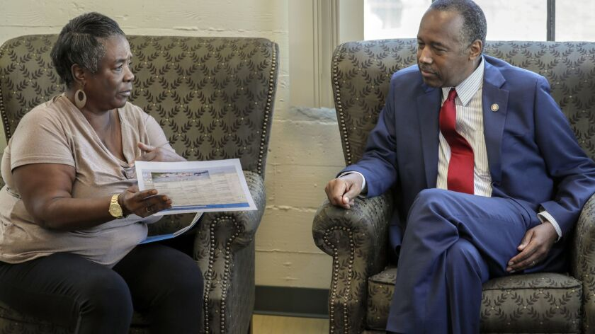 Housing and Urban Development Secretary Ben Carson meets volunteer aide and participant Denise Smith while visiting the Downtown Women's Center in Los Angeles on Tuesday.
