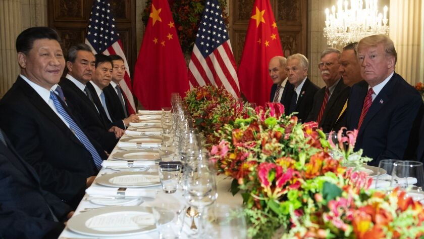 President Trump, Chinese President Xi Jinping and others around a table at the G-20 conference last year.
