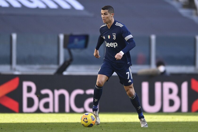 Juventus' Cristiano Ronaldo goes for the ball during the Serie A soccer match between Juventus and Bologna, at the Allianz Stadium in Turin, Italy, Sunday, Jan. 24, 2021. (Fabio Ferrari/LaPresse via AP)