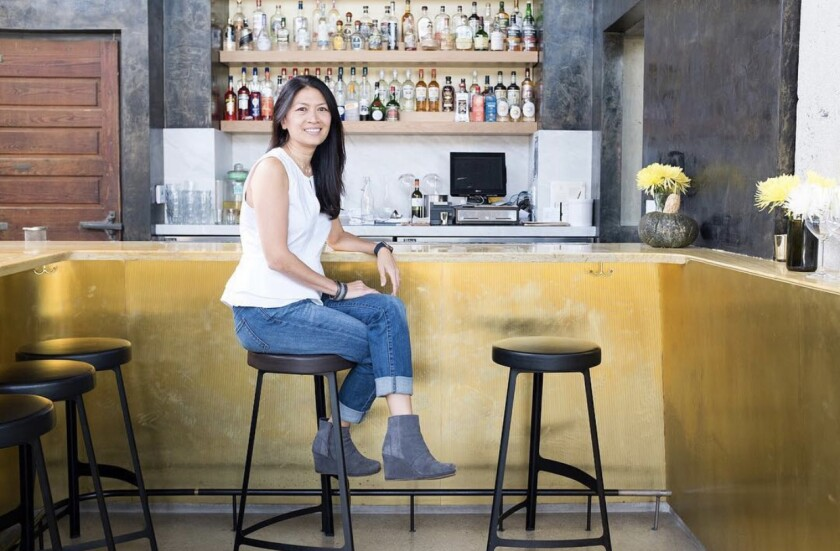Dina Samson sits at her restaurant counter