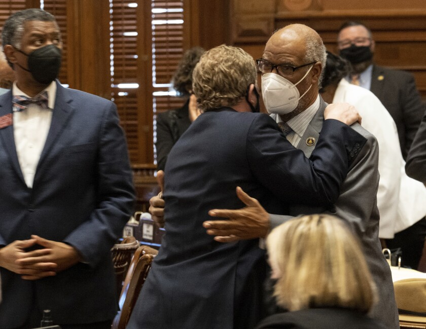 Rep. Bert Reeves (R-Marietta), left, hugs Rep. Calvin Smyre (D-Columbus) after the passage of HB 479, which would reform citizen arrest laws, Monday evening, March 8, 2021. (Ben Gray/Atlanta Journal-Constitution via AP)