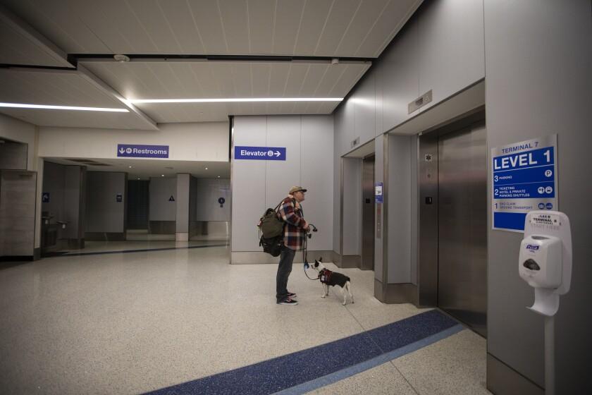 A man and his dog at LAX