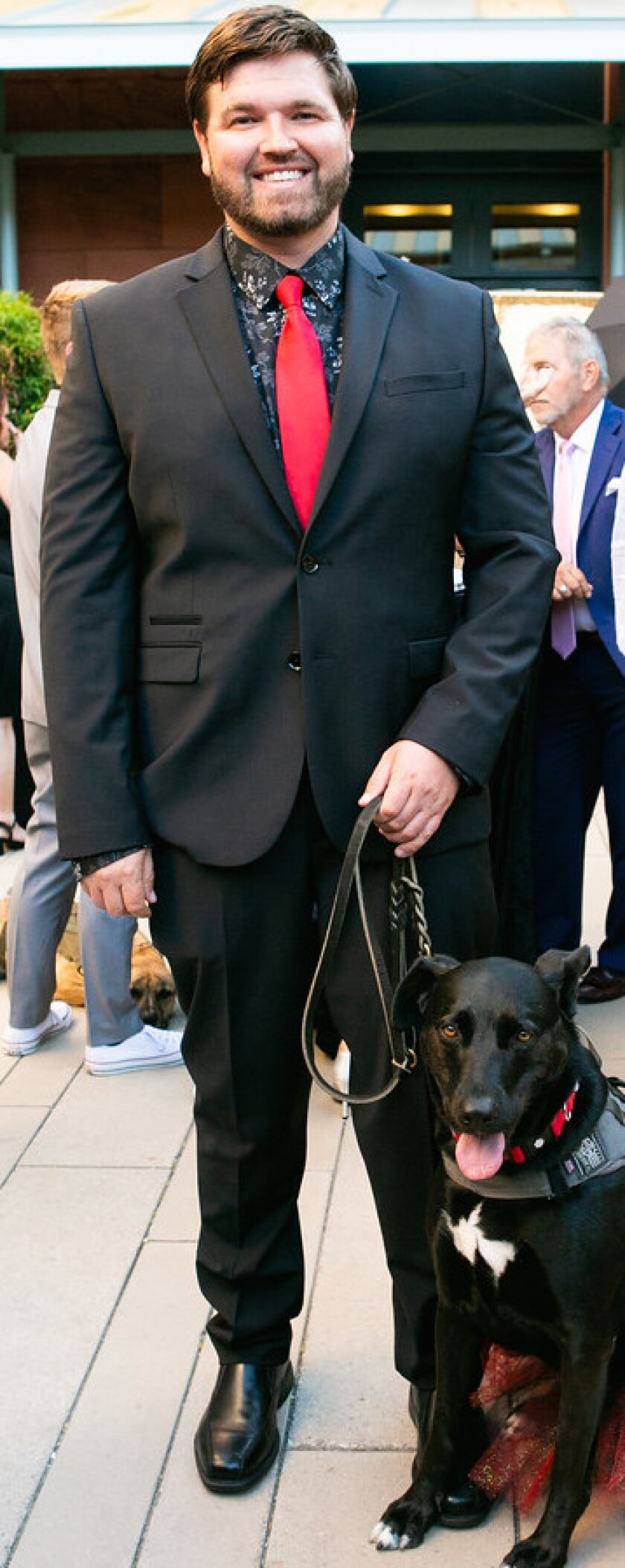 Aaron Neely, USN, and Liberty, STS service dog